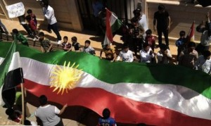 Kurdish flag carried in Amude, Syria, 2012
