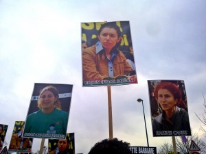 Placards showing Leyla Şaylemez, Fidan Dogan and Sakine Cansiz