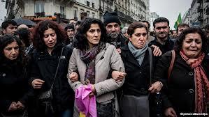 Kurdish women mourn and march