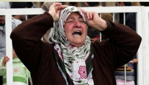 Woman mourns following Al Nusra massacre in Tal Abyad