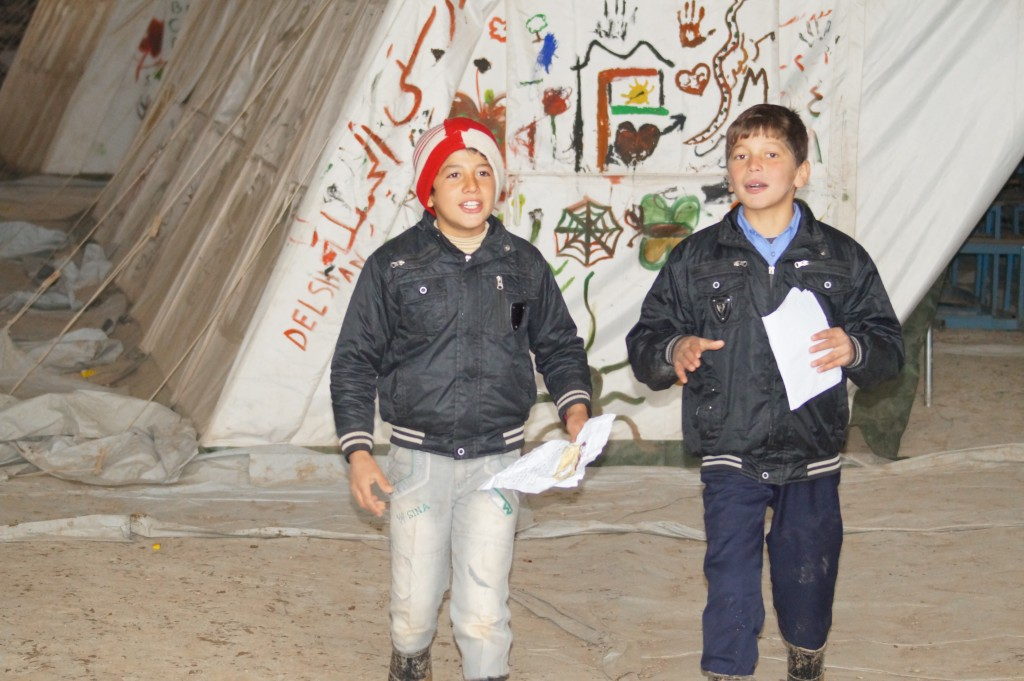 Two pupil walking around the tents memorising dialogue given for the next lesson