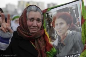 A woman mourns defiantly, Paris, Jan 2013