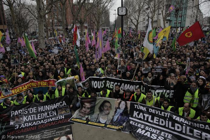 """FRANCE.PARIS. 12/01/2013: Thousands of Kurds from across Europe marched in Paris on Saturday, demanding justice for three activists shot dead in the French capital. """"We are all PKK"""" and """"The martyrs won't die"""" were some of the slogans which the crowd chanted, raising Kurdish flags and giant banners plastered with photos of the three women and Abdullah Ocalan, one of the founding members of Kurdistan Workers' Party (PKK)."""