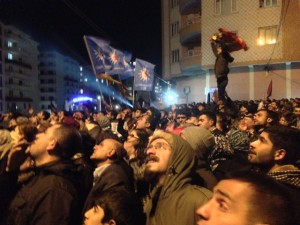 Crowds watch results on screen outside BDP HQ, Amed