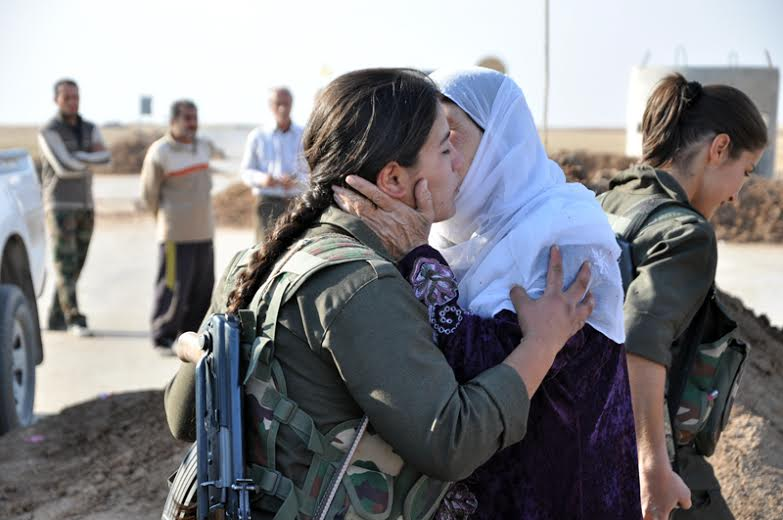 In central Tirbespiye, family members welcome back their daughters after YPJ announced on the radio that all outskirt villages of Tirbespiye were liberated on 12 November 2013