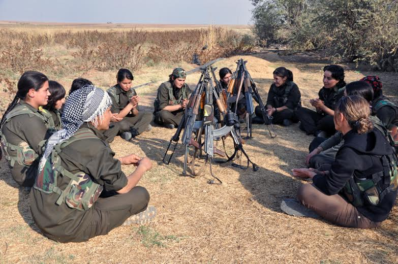 YPJ women fighters holding their regular meeting before finally entering the front line.