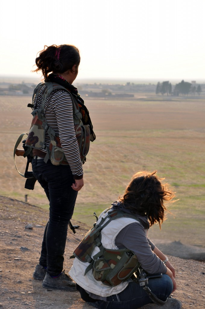 Two YPJ fighters resting and looking over Tirbespiye just after they hear that the al-Nusra Front and ISIS have completely withdrawn from the surrounding villages