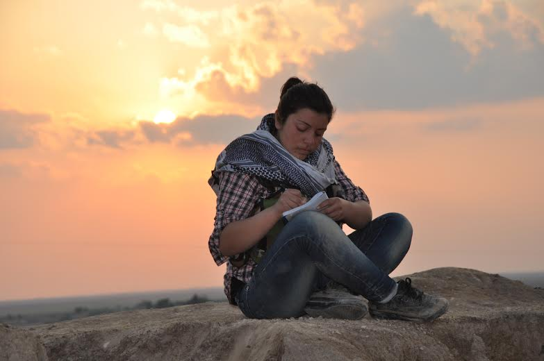 9.A YPG fighter writing her diary before going back to Tirbespiye.