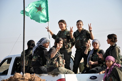 A YPJ company celebrating victory on the front line and en route back to central Tirbespiye