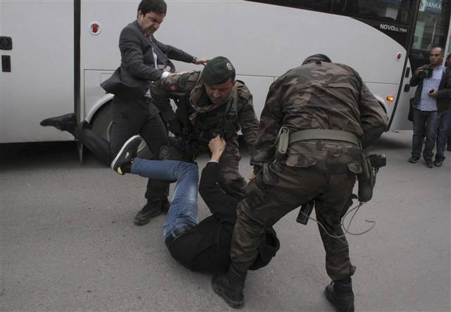 Erdogan aide kicks one of the mourners yesterday