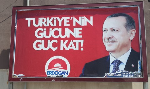 ...Roboski massacre poster replaced with Erdoğan campaign poster, August 2014