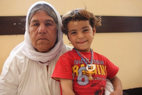 Hajar and Dilo, two generations of a Yezidi family. Hajar has become the sole protector of 8 people.