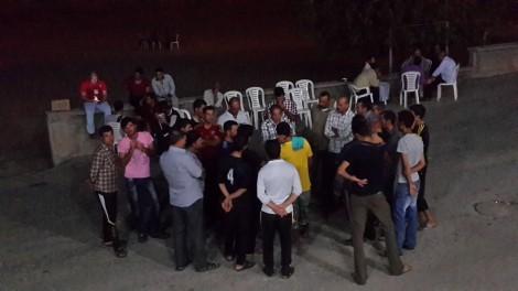 Yezidis in Batman gather around to tell Beam their stories