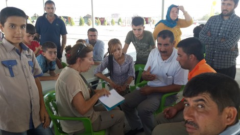 Beam listens to Yezidis and camp manager in Bismil Sept 11
