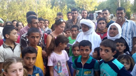 Amy Beam is surrounded by Yezidis wanting to talk to her