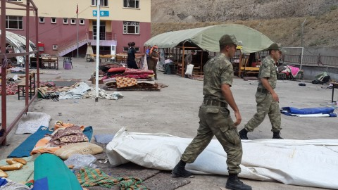 Jandarma soldiers stationed in Roboski help take down tents and clean