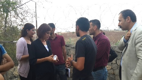 Özlem Onuk, Sirnak co-mayor (in black), Ismail Ike, (jacket) camp director