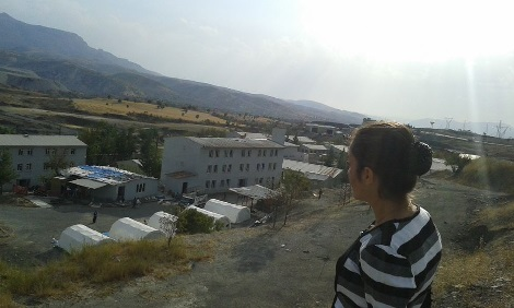 Adib looks down over her home in Sirnak, Turkey, which houses 1400 Ezidi refugees from Shingal. It is supported by local Kurds.