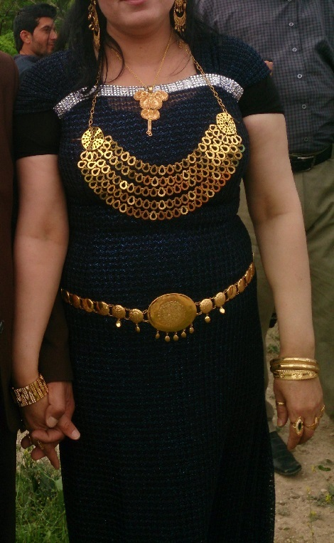 An Ezidi woman is wearing the family gold