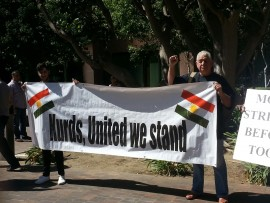 Rick Trujillo stands with the Kurds