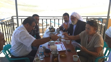 Fikret Taşkin meets with Dr. Amy Beam and Khalaf Saido Rasho (beard), Batman