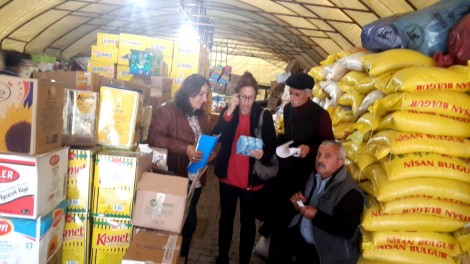 Amy Beam is shown BDP donations tent for Ezidis and Kobane Kurds