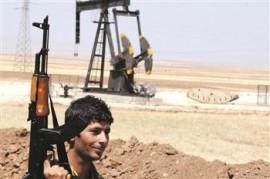 Kurdish fighter guarding oil well in Rimelan, 2013