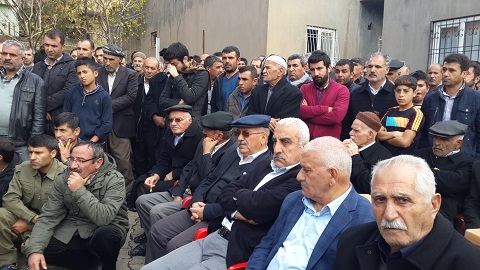 Mesut Uysal, third from right seated, returned after 22 yrs Mesut Uysal's house attacked by police in 1992