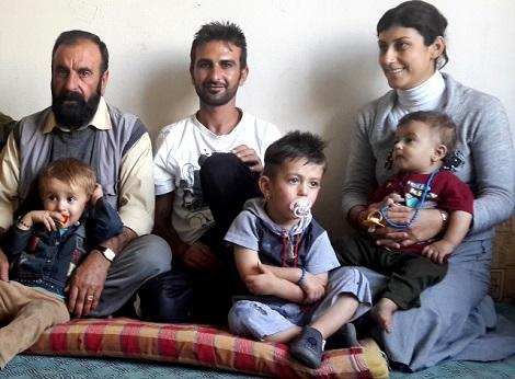 Yazidi interpreter Farhan Mahlo with his family