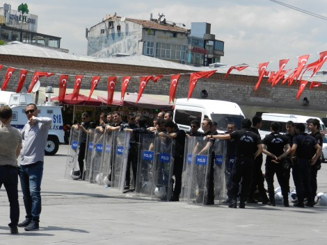 Police, in an out of uniform, protecting Taksim Square from the public
