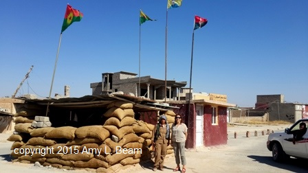 YPJ-S guard at entrance to Snony, Shengal, with Amy L. Beam