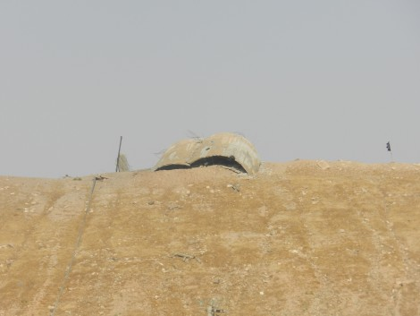 Abandoned ISIS position (flag on right)