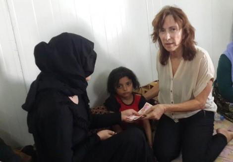005 20150718_amy_beam_donates_to_yezidi