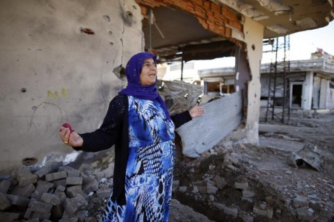 A woman in front of her ruined house in Cizre following recent 'military operations' (AP Photo/Emrah Gurel)
