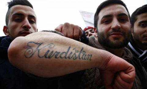 Pro-Kurdish demonstrator displays tattoo as he attends rally against 20 year ban of PKK in Berlin