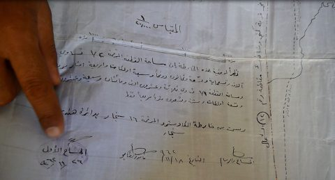 deed with Sheikh Khalaf and brother Sheikh Barakat's signatures, government stamp, date of 1962
